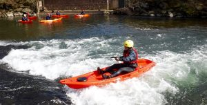 whitewater in a Sit on Top kayak